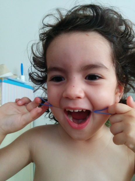 Emanuelle 2.9 y/o using the Gummy Floss™ and having fun!